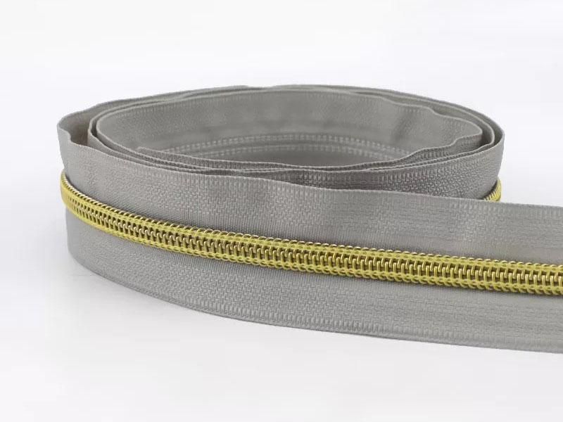 Reißverschluss endlos 1m in hellgrau/gold